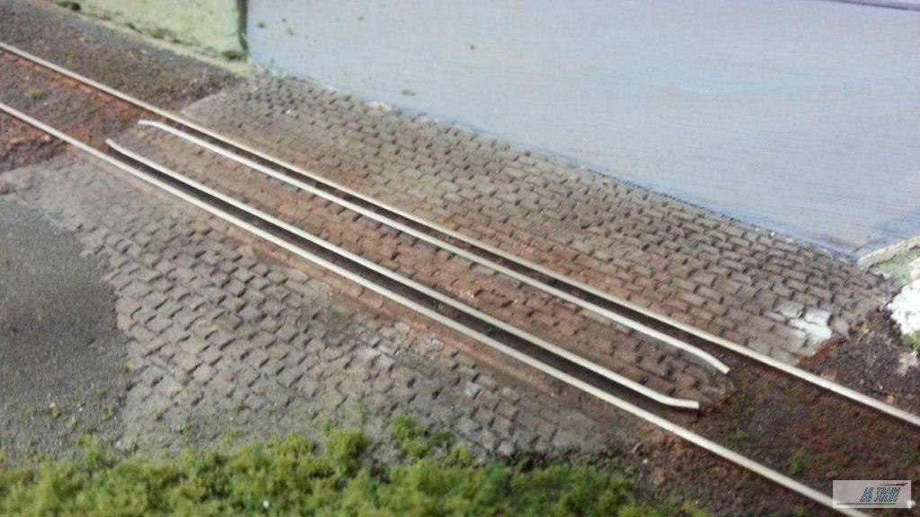 Patine de la voie - Des pavés pour un passage routier